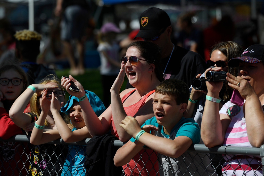. Fans applaud their favorite athletes that were on the podium accepting medals at the Colorado Track and Field State Championships at Jeffco Stadium May 21, 2016. (Photo by Andy Cross/The Denver Post)