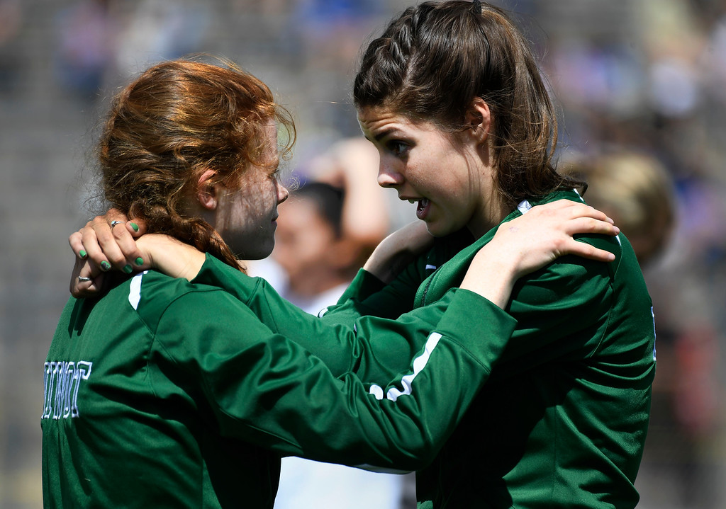 . LAKEWOOD, CO - May 19: Niwot teammates Mary Gillett, left, and MacKenzie Minerich motivate each other before their class 4A 400 meter dash preliminary race at the Colorado State High School Track and Field Championships at Jeffco Stadium May 19, 2016. (Photo by Andy Cross/The Denver Post)