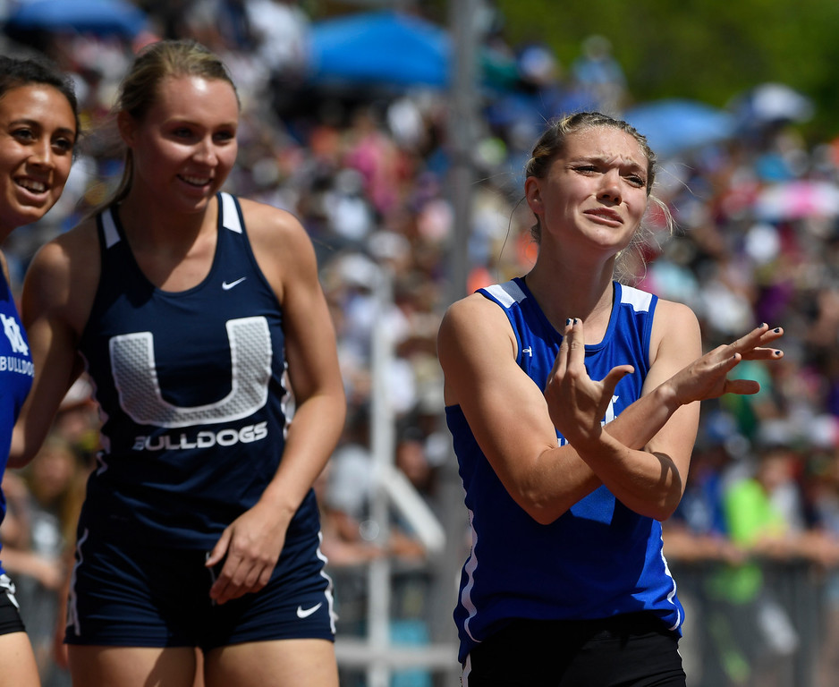 . Kayla Pinnt, Moffat County, right, won the 3A 100 meter dash final, but wasn\'t happy with her time that didn\'t set a new record at the Colorado Track and Field State Championships at Jeffco Stadium May 21, 2016. Second place finisher Delaney Morrow, University, center, and teammate Selena Hernandez, left, who finished third, look up at the scoreboard to see their scores. (Photo by Andy Cross/The Denver Post)