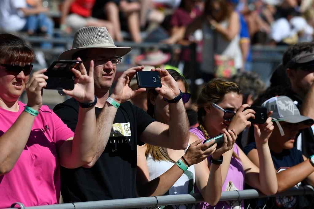 . Parents, friends and family take photos of podium at the Colorado Track and Field State Championships at Jeffco Stadium May 21, 2016. (Photo by Andy Cross/The Denver Post)
