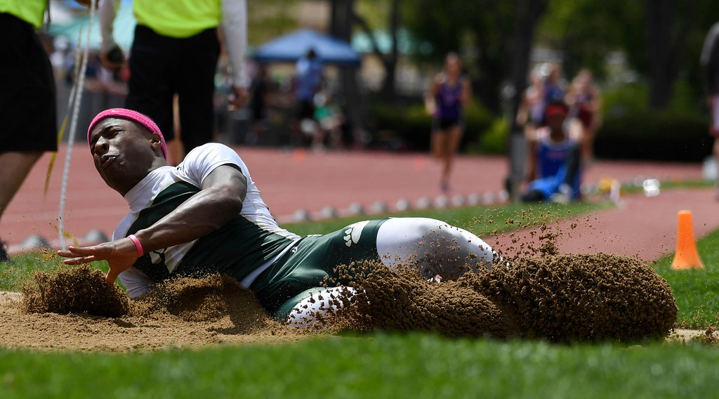 . LAKEWOOD, CO - May 19: To\'mas Randolph hits the sand pit during the boys 5A long jump finals at the Colorado State High School Track and Field Championships at Jeffco Stadium May 19, 2016. (Photo by Andy Cross/The Denver Post)