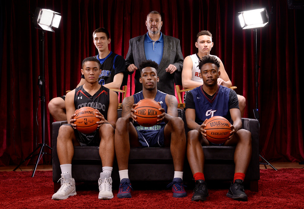 . The  Colorado All-State basketball team for boys at The Denver Post on Wednesday, March 30, 2016. Top row left to right: Justinian Jessup, of Longmont, Coach of the year Bobby Tyler of Pueblo West, Colbey Ross of Eaglecrest. Lower row left to right: Justin Bassey, Colorado Academy, De\'Ron Davis, of Overland, and David Thornton, Cherokee Trail.  (Photo by Cyrus McCrimmon/ The Denver Post)