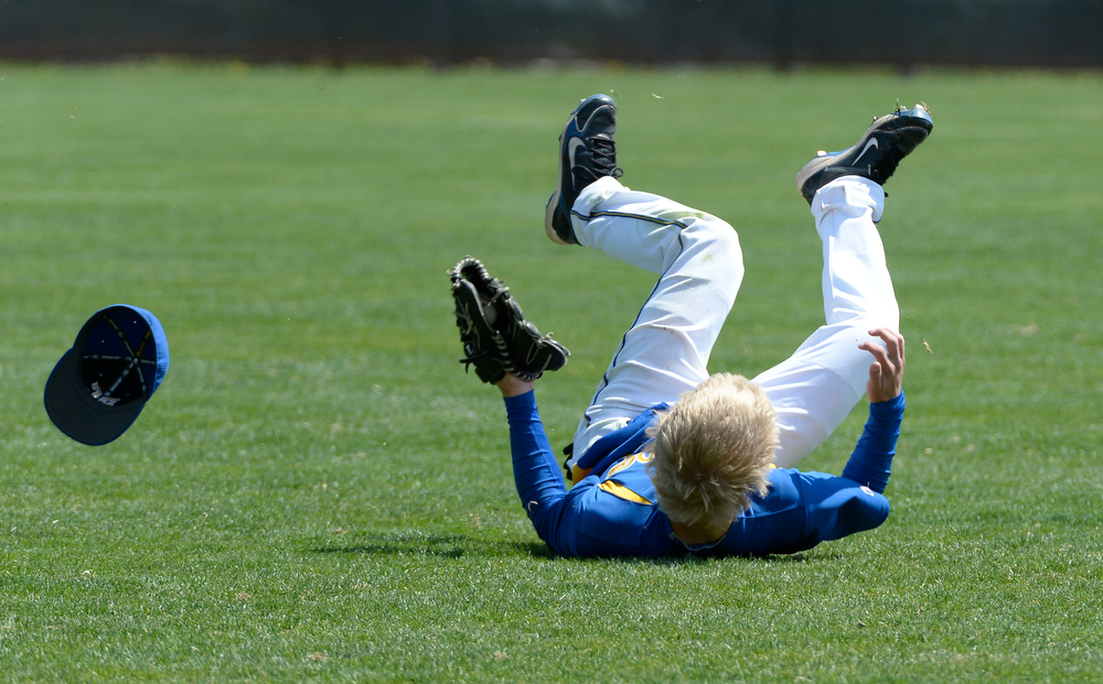 . Dove Creek Case Baughman (12) makes a diving catch on a hit by Caliche Ryan Walther for the out in the Championship game May 15, 2014 at All-Star Park. Caliche defeated Dove Creek 17-1 for the title. (Photo by John Leyba/The Denver Post)