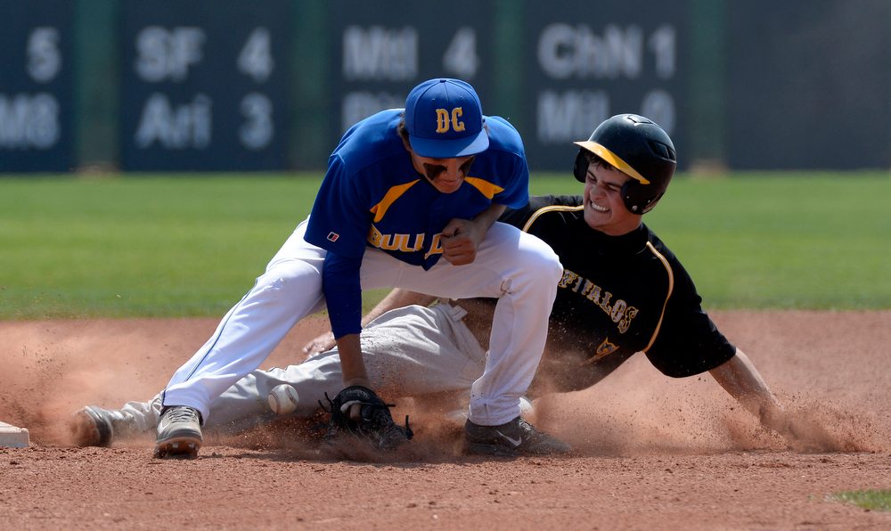 . Caliche Austin Yahn (7) gets tagged out at second by Dove Creek Jordan Ernst (8) in the Championship game May 15, 2014 at All-Star Park. Caliche defeated Dove Creek 17-1 for the title. (Photo by John Leyba/The Denver Post)