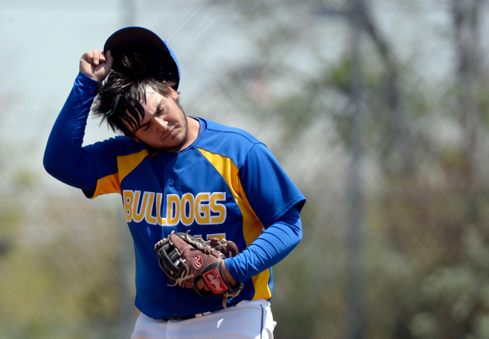 . Dove Creek pitcher Tyson Smith (45) adjusts his hat in the 6th inning during their Championship game against Caliche May 15, 2014 at All-Star Park. Caliche defeated Dove Creek 17-1 for the title. (Photo by John Leyba/The Denver Post)
