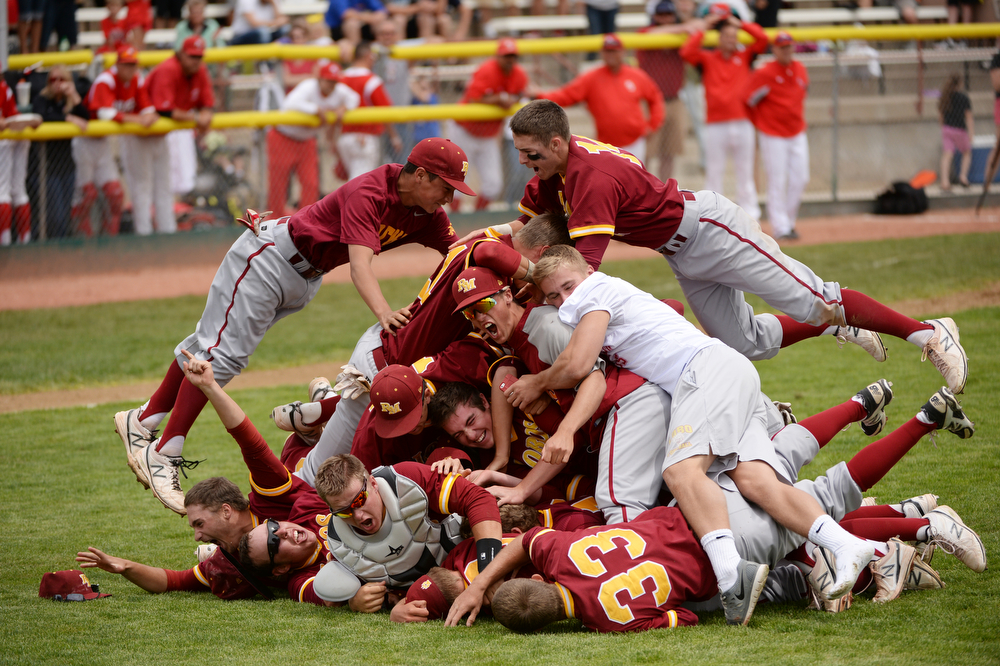 . Rocky Mountain High School baseball team celebrate winning of 5A state championship game against Regis Jesuit High School at All City Stadium. Denver, Colorado. May 24. 2014. Rocky Mountain High School won 6-5. (Photo by Hyoung Chang/The Denver Post)