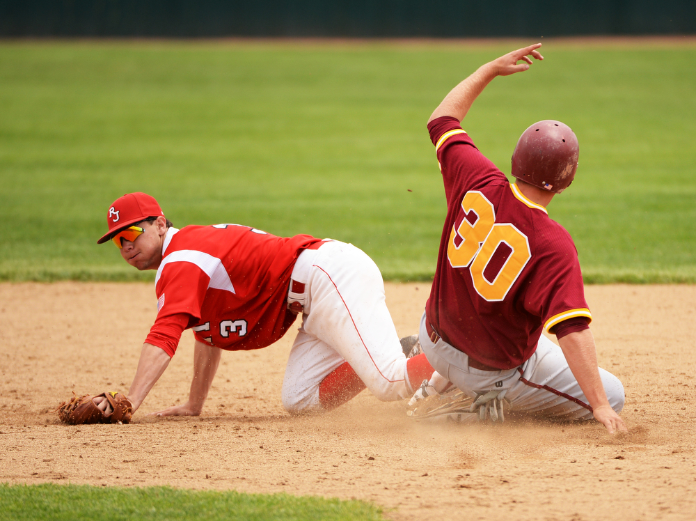 . RockyMax George of Regis Jesuit High School (3) tag Carl Stajduhar of Rocky Mountain High School (30) at All City Stadium. Denver, Colorado. May 24. 2014. Rocky Mountain High School won the 5A state championship game by 6-5. (Photo by Hyoung Chang/The Denver Post)