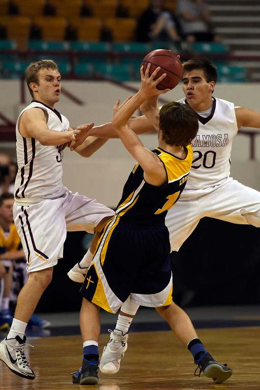 . CS Christian Lions Trey Nielsen (12) gets double teamed by Alamos Mean Moose Clayton Brubacher (3) and Marco Garcia (20) during the Championship 3A game at the Coliseum. (Photo By John Leyba/The Denver Post)