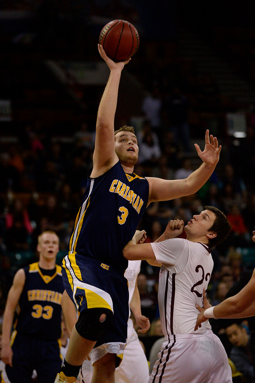 . CS Christian Lions Sam Howard (3) takes a shot over Alamos Mean Moose Austin Milner (22)  during the Championship 3A game at the Coliseum. (Photo By John Leyba/The Denver Post)