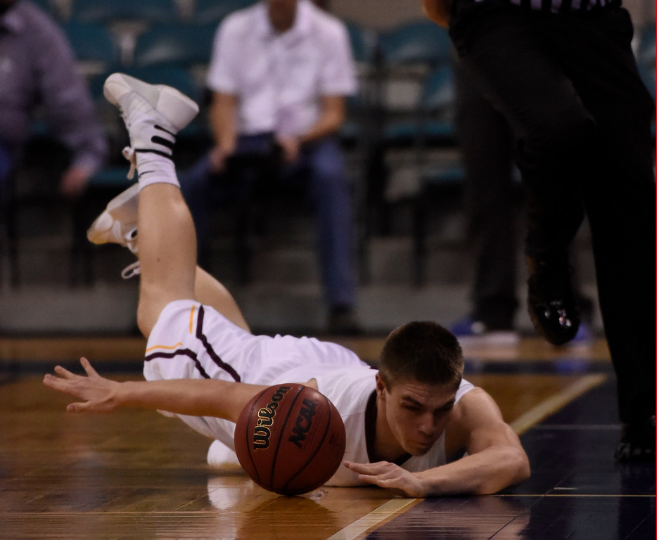 . Alamos Mean Moose Robbie Alejo (5) dives after ball as it goes out of bounds during the second quarter against the CS Christian Lions during the Championship 3A game at the Coliseum. (Photo By John Leyba/The Denver Post)
