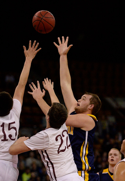 . CS Christian Lions Sam Howard (3) takes a shot over Alamos Mean Moose Angelo Ramirez (15) and Austin Milner (22) during the Championship 3A game at the Coliseum. (Photo By John Leyba/The Denver Post)