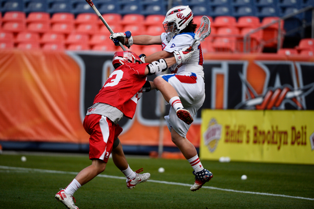. Cherry Creek goalie, Addison Christensen, right, gets pressure from Ben Bechter, Regis during the Colorado State 5A boys lacrosse Championship at Sports Authority Field at Mile High Saturday evening, May 17, 2014. (Photo By Andy Cross / The Denver Post)