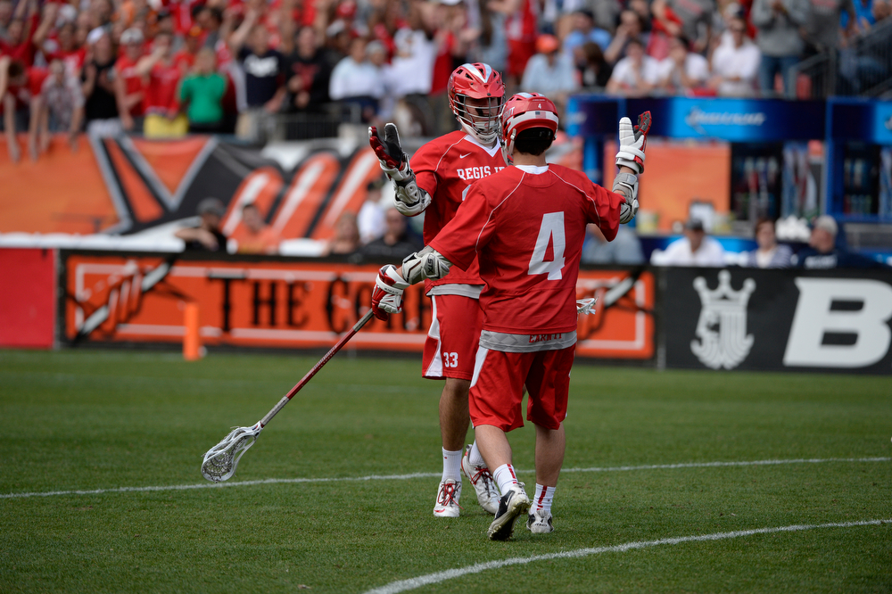 . Regis lacrosse teammates, Matt Soran, left, and Chet Dunstan, celebrate Soran\'s goal against Cherry Creek during the Colorado State 5A boys lacrosse Championship at Sports Authority Field at Mile High Saturday evening, May 17, 2014. (Photo By Andy Cross / The Denver Post)