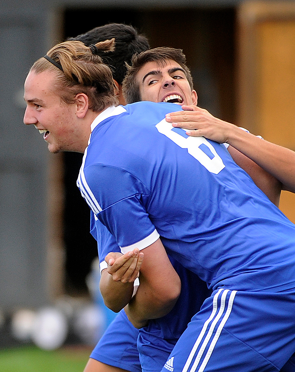 . Grandview senior striker Alex Simpson (8) celebrated with teammates following his first half goal. The Grandview High School boy\'s soccer team defeated Arapahoe 2-0 Thursday evening, September 19, 2013.  Photo By Karl Gehring/The Denver Post