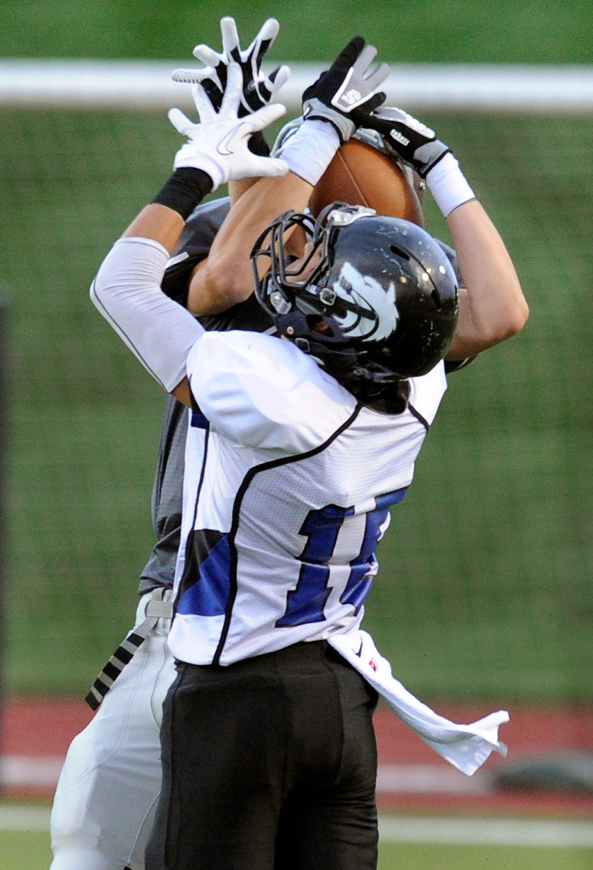 . Hawks receiver Koy Bowen (6) beat defender Beau Martinez (15) for a catch in the first quarter. The Horizon High School football team hosted Grandview Thursday night, August 29, 2013.  Photo By Karl Gehring/The Denver Post