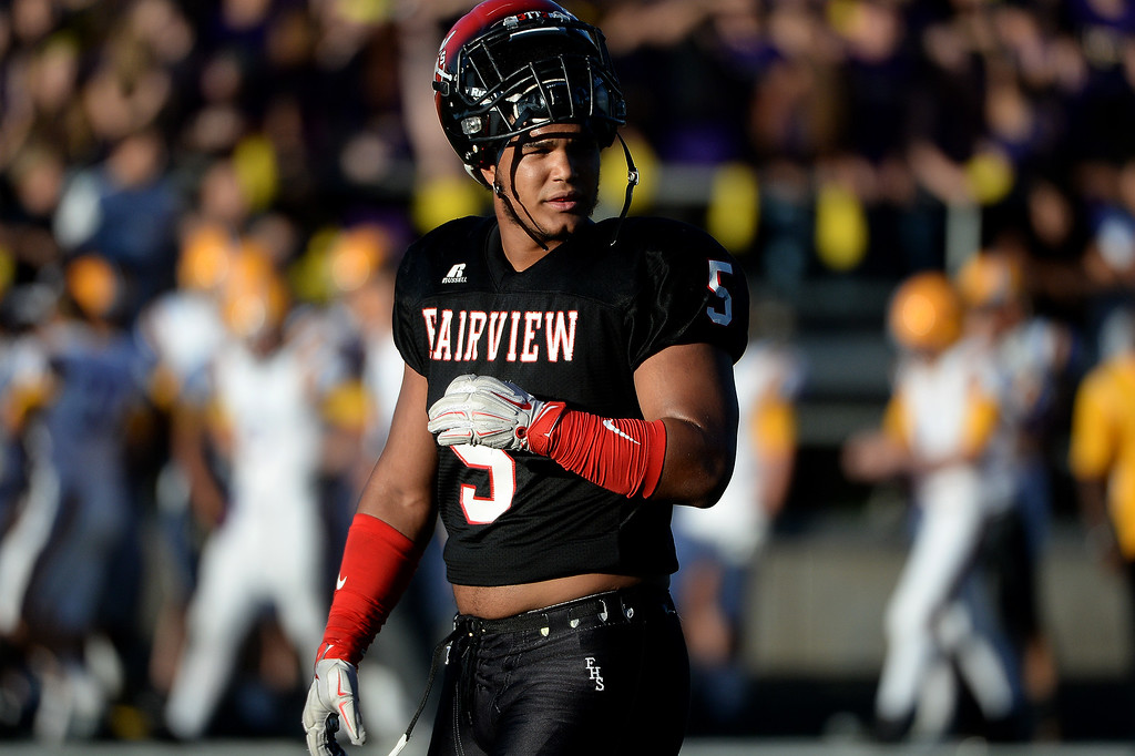 . Carlo Kemp takes a breather during second game of the season against Boulder on Friday, September 11, 2015. In Kemp\'s time as a four-year varsity player, the Knights never lost a game to their crosstown rivals. (Photo by AAron Ontiveroz/The Denver Post)
