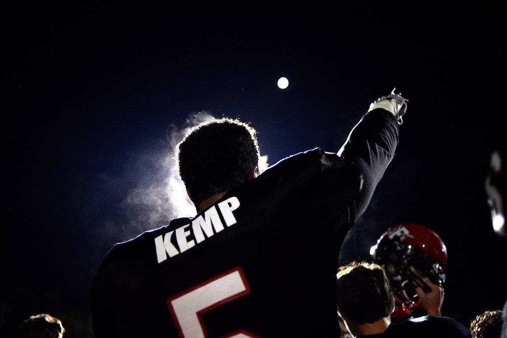 . Carlo Kemp sings the school\'s fight song after a 30-16 over Fossil Ridge on Friday, October 23, 2015. (Photo by AAron Ontiveroz/The Denver Post)