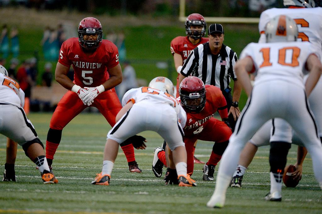 . Carlo Kemp (5) eyeballs Grand Junction quarterback Jax Nourse on Friday, September 5, 2015. (Photo by AAron Ontiveroz/The Denver Post)