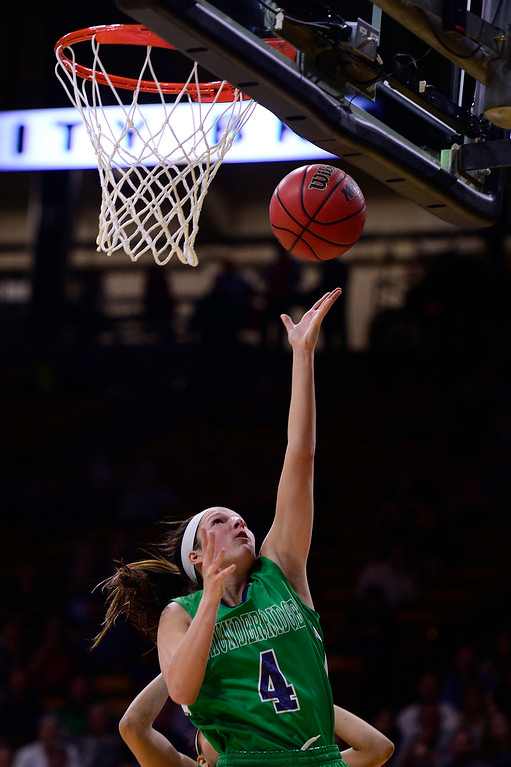 . Taylor Rusk (4) of ThunderRidge throws up a lay up during the second quarter at the Coors Events Center on March 12, 2016 in Boulder, Colorado. (Photo by Brent Lewis/The Denver Post)