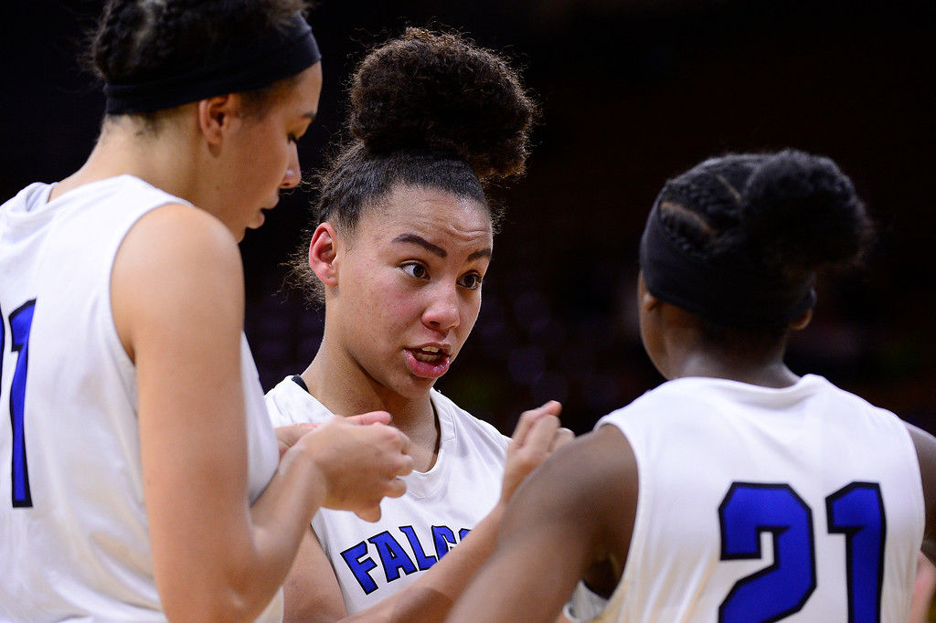 . Leilah Vigil (30) of Highlands Ranch talks to Symone Starks (21) of Highlands Ranch before the start of the second half against ThunderRidge at the Coors Events Center on March 12, 2016 in Boulder, Colorado. ThunderRidge defeated Highlands Ranch 47-32 to win the Class 5A Colorado State Basketball Championship. (Photo by Brent Lewis/The Denver Post)