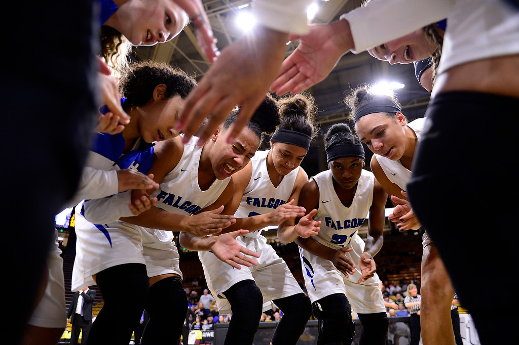. Highlands Ranch huddles before the start of their game against ThunderRidge at the Coors Events Center on March 12, 2016 in Boulder, Colorado. (Photo by Brent Lewis/The Denver Post)