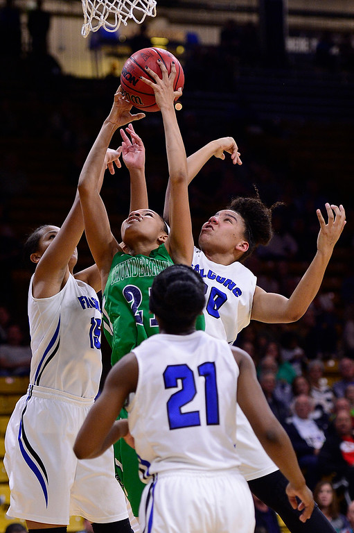 . Dallas Petties (21) of ThunderRidge gets surrounded by Autumn Watts (15). Symone Starks (21) and Leilah Vigil (30) of Highlands Ranch while going for a rebound during the fourth quarter at the Coors Events Center on March 12, 2016 in Boulder, Colorado. ThunderRidge defeated Highlands Ranch 47-32 to win the Class 5A Colorado State Basketball Championship. (Photo by Brent Lewis/The Denver Post)