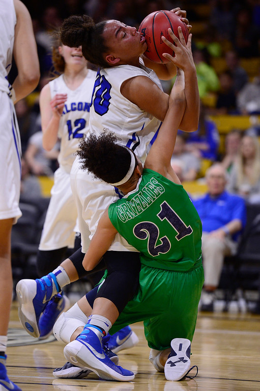 . Leilah Vigil (30) of Highlands Ranch and Dallas Petties (21) of ThunderRidge fight over a loose ball during the second quarter at the Coors Events Center on March 12, 2016 in Boulder, Colorado. (Photo by Brent Lewis/The Denver Post)
