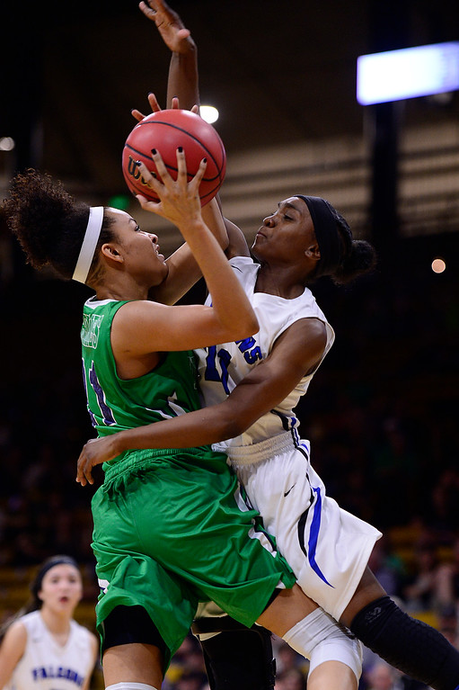 . Dallas Petties (21) of ThunderRidge makes contact with Symone Starks (21) of Highlands Ranch in the air during the first quarter at the Coors Events Center on March 12, 2016 in Boulder, Colorado. (Photo by Brent Lewis/The Denver Post)