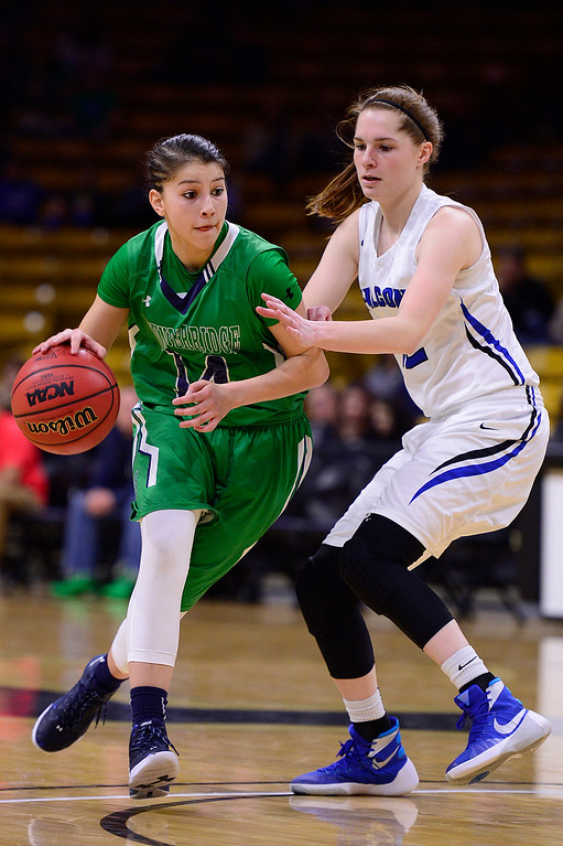 . Alyssia Martinez (14) of ThunderRidge drives to the basket while defended by Courtney Humbarger (12) of Highlands Ranch during the second quarter at the Coors Events Center on March 12, 2016 in Boulder, Colorado. (Photo by Brent Lewis/The Denver Post)