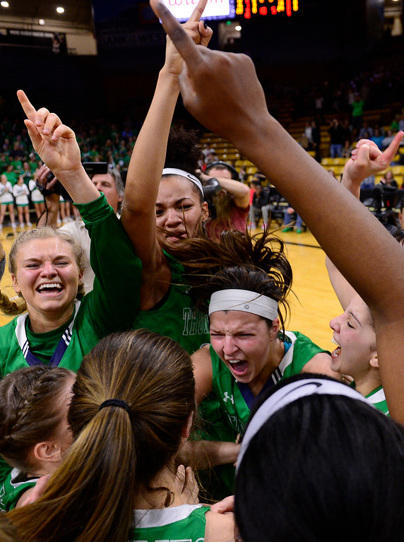 . ThunderRidge celebrates with the trophy after defeating Highlands Ranch at the Coors Events Center on March 12, 2016 in Boulder, Colorado. ThunderRidge defeated Highlands Ranch 47-32 to win the Class 5A Colorado State Basketball Championship. (Photo by Brent Lewis/The Denver Post)