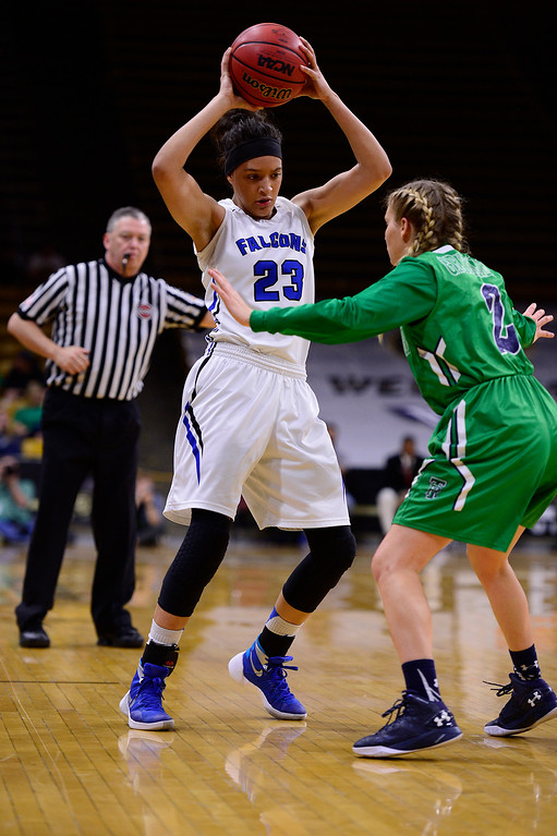. Brianne Stiers (23) of Highlands Ranch looks for a passing lane around Madison Ward (2) of ThunderRidge during the third quarter at the Coors Events Center on March 12, 2016 in Boulder, Colorado. ThunderRidge defeated Highlands Ranch 47-32 to win the Class 5A Colorado State Basketball Championship. (Photo by Brent Lewis/The Denver Post)