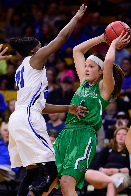 . Taylor Rusk (4) of ThunderRidge looks for a passing lane around the defense of Symone Starks (21) of Highlands Ranch during the first quarter at the Coors Events Center on March 12, 2016 in Boulder, Colorado. (Photo by Brent Lewis/The Denver Post)