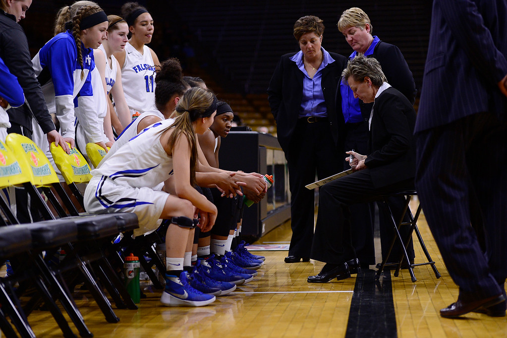. Head coach Caryn Jarocki of Highlands Ranch talks with her team on a timeout during the third quarterat the Coors Events Center on March 12, 2016 in Boulder, Colorado. ThunderRidge defeated Highlands Ranch 47-32 to win the Class 5A Colorado State Basketball Championship. (Photo by Brent Lewis/The Denver Post)
