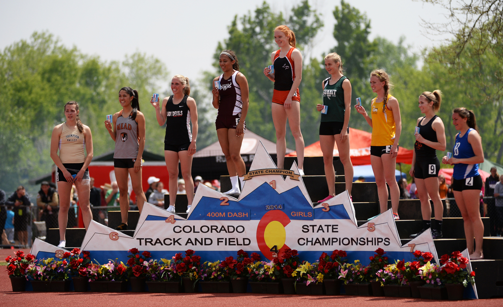 . Nicole Montgomery of Lewis-Palmer High School, top, celebrates her winning of 4A girls 400m dash during Colorado High School state track and field meet at JeffcoStadium. Lakewood, Colorado. May 17. 2014. (Photo by Hyoung Chang/The Denver Post)