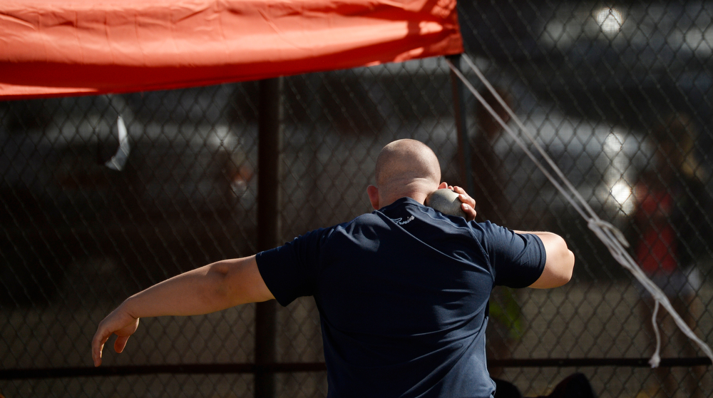 . Justin Williams, a 3A shot putter from Cedaredge High School competes during the Colorado High School State Track and Field Championships, May 16, 2014. Action will continue through Saturday at Jeffco Stadium in Lakewood. (Photo by RJ Sangosti/The Denver Post)