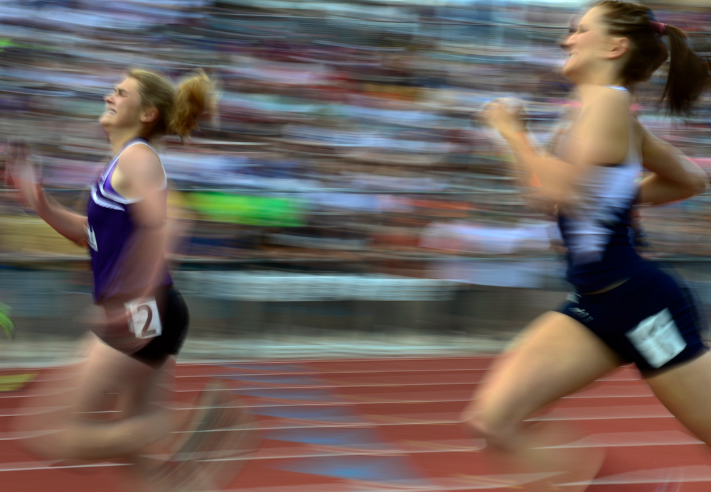 . Competitors sprint for the finish line in the 3A Girls 400 Meter Dash event. The Colorado State High School Track and Field meet takes place at Jeffco Stadium in Lakewood on Saturday, May 17, 2014. (Kathryn Scott Osler, The Denver Post)