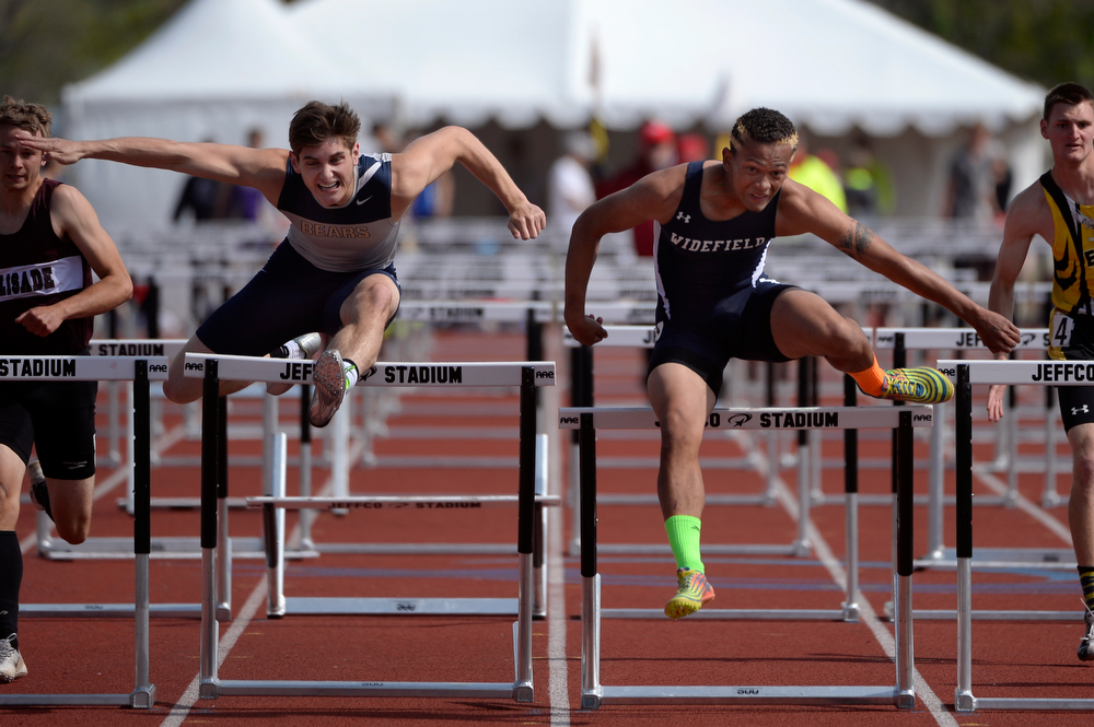 . Kyree Gerstle-Goodman from Widefield and Evan Malin from Palmer Ridge are neck and neck in the 4A Boys 110 Meter Hurdle Event. Gerstle-Goodman took first place and Malin took second. The Colorado State High School Track and Field meet takes place at Jeffco Stadium in Lakewood on Saturday, May 17, 2014. (Kathryn Scott Osler, The Denver Post)