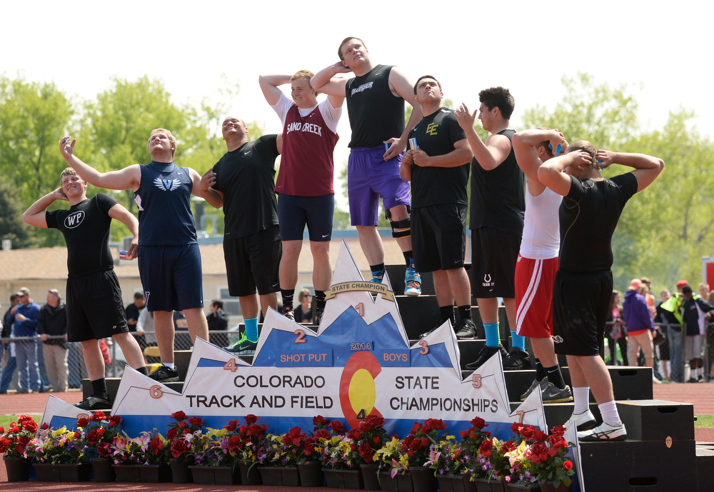 . Medalist in the 4A shot put mess around for picture on the medal stand during the Colorado High School State Track and Field Championships, May 15, 2014. Action will continue through Saturday at Jeffco Stadium in Lakewood. (Photo by RJ Sangosti/The Denver Post)