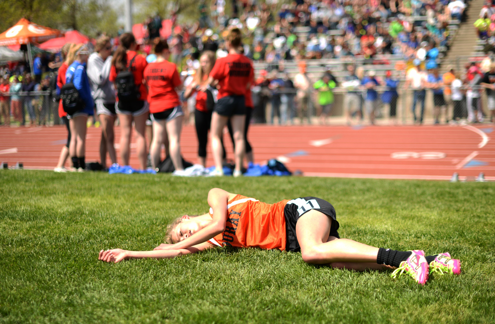 . Sabine Lindler of Ouray High School lie on the field after her 2A girls 1600m run during Colorado high school state track and field meet at Jeffco Stadium. Lakewood, Colorado. May 17. 2014. (Photo by Hyoung Chang/The Denver Post)