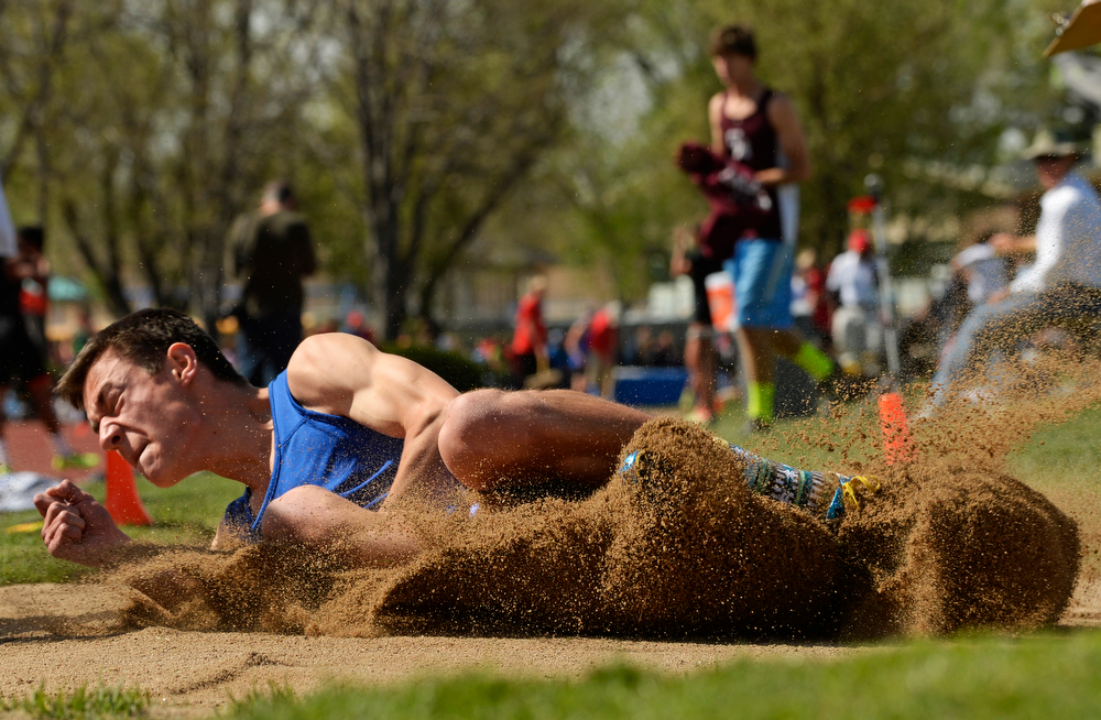 . Peter Greco, of Wheat Ridge High School, competes in the long jump during the Colorado High School State Track and Field Championships, May 16, 2014. Action will continue through Saturday at Jeffco Stadium in Lakewood. (Photo by RJ Sangosti/The Denver Post)