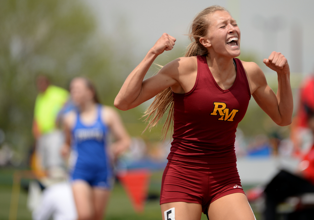 . Rocky Mountain High\'s Carly Lester celebrate winning of 5A Girls 300m hurdle and set the state record during Colorado high school state track and field meet at Jeffco Stadium. Lakewood, Colorado. May 17. 2014. (Photo by Hyoung Chang/The Denver Post)