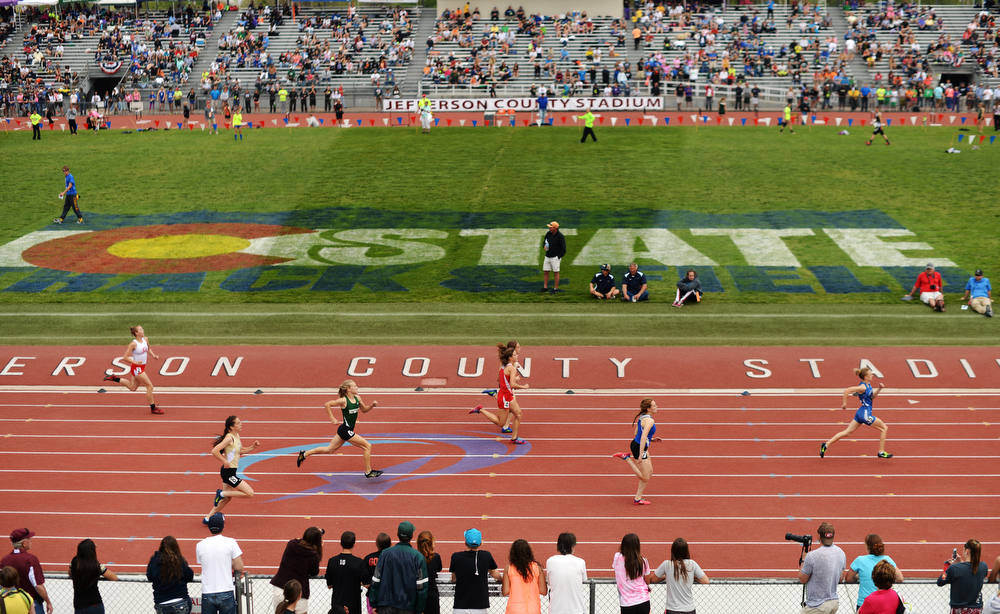 . Athletes are competing 4A girls 300m hurdles during Colorado high school state track and field meet at Jeffco Stadium. Lakewood, Colorado. May 17. 2014. (Photo by Hyoung Chang/The Denver Post)