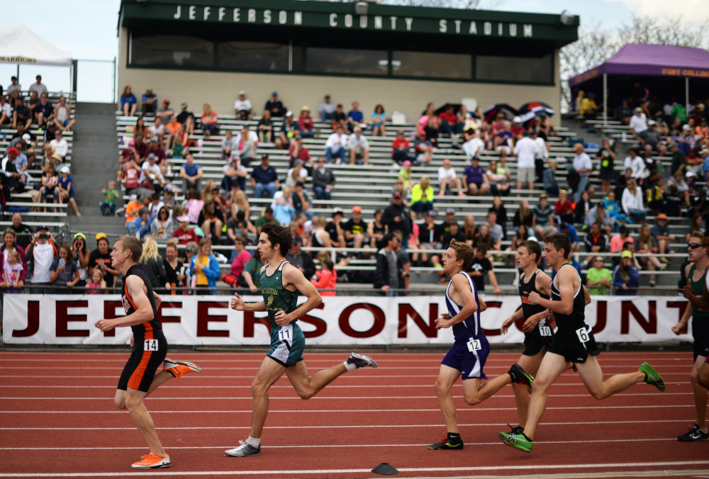 . Athletes are competing 3A boys 1600m during Colorado high school state track and field meet at Jeffco Stadium. Lakewood, Colorado. May 17. 2014. (Photo by Hyoung Chang/The Denver Post)