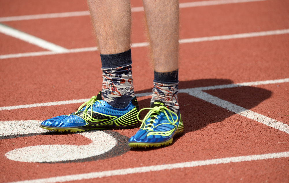 . Collin Molleur, of Evergreen High School, supports some colorful dress socks as he competes at the Colorado High School State Track and Field Championships, May 15, 2014. Action will continue through Saturday at Jeffco Stadium in Lakewood. (Photo by RJ Sangosti/The Denver Post)