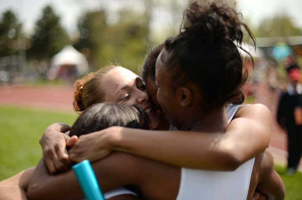 . From left, Jaylynn Guy, Alyssa Evans, Ashley Register and Deaijah Paulk of Harrison High School celebrate winning of 4A girls 4 x 100 relay during Colorado high school state track and field meet at Jeffco Stadium. Lakewood, Colorado. May 17. 2014. (Photo by Hyoung Chang/The Denver Post)