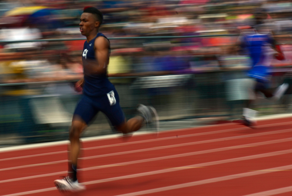 . Brandon Singleton sprints toward the finish line in the 5A Boys 400 Meter Dash event. The Colorado State High School Track and Field meet takes place at Jeffco Stadium in Lakewood on Saturday, May 17, 2014. (Kathryn Scott Osler, The Denver Post)