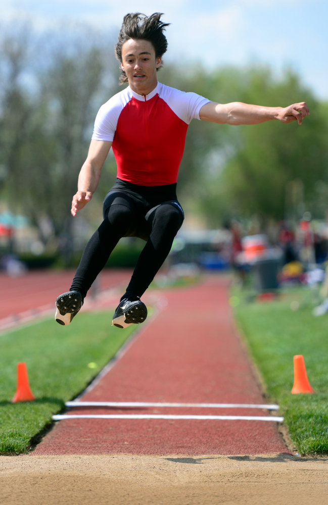 . Dalton Waln competes in the Boys Long Jump Event for Eaton High School. The Colorado State High School Track and Field meet takes place at Jeffco Stadium in Lakewood on Saturday, May 17, 2014. (Kathryn Scott Osler, The Denver Post)