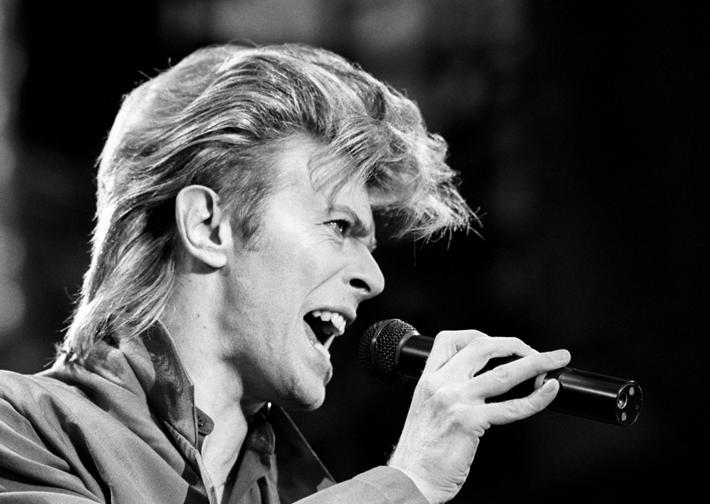 . FILE - This is a June 19, 1987 file photo of David Bowie. Bowie, the other-worldly musician who broke pop and rock boundaries with his creative musicianship, nonconformity, striking visuals and a genre-bending persona he christened Ziggy Stardust, died of cancer Sunday Jan. 10, 2016. He was 69 and had just released a new album. (PA, File via AP) UNITED KINGDOM OUT  NO SALES NO ARCHIVE