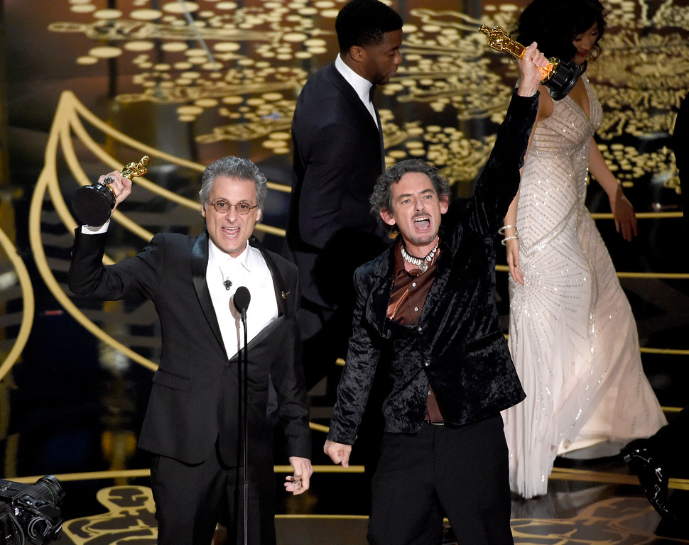 . Mark Mangini, left, and David White accept the award for best sound editing for �Mad Max: Fury Road� at the Oscars on Sunday, Feb. 28, 2016, at the Dolby Theatre in Los Angeles. (Photo by Chris Pizzello/Invision/AP)