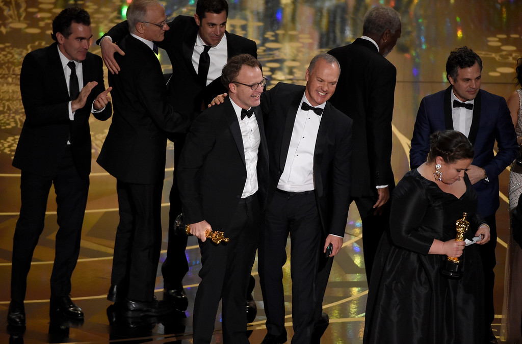 ". Tom McCarthy, center left, and Michael Keaton, center right, accept the award for best picture for ""Spotlight\"" at the Oscars on Sunday, Feb. 28, 2016, at the Dolby Theatre in Los Angeles. (Photo by Chris Pizzello/Invision/AP)"